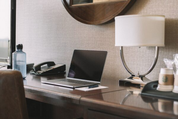 laptop on top of a hotel room table