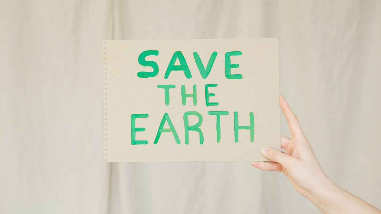 07_Paper showing save the earth message for sustainability