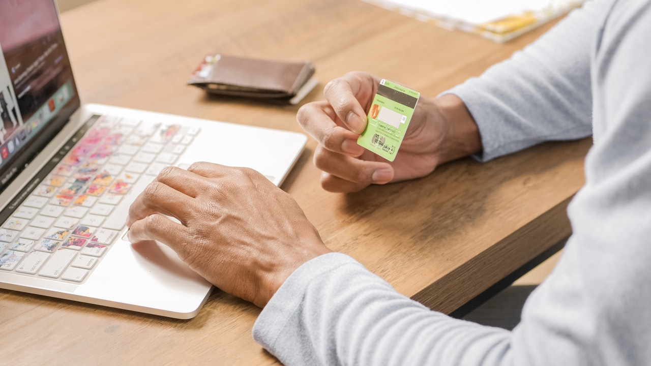 11_A man booking online with a credit card