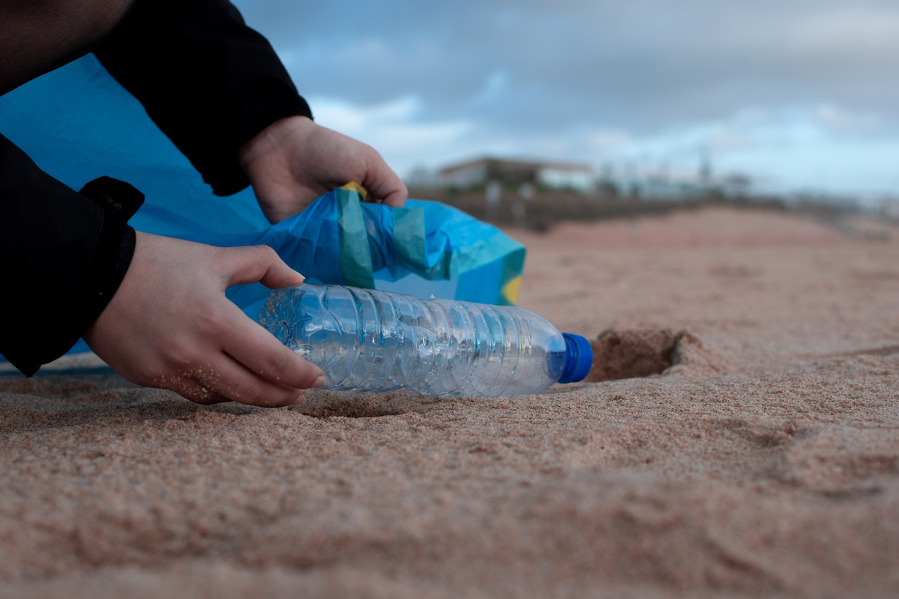 09_A plastic bottle on a beach during a clean up