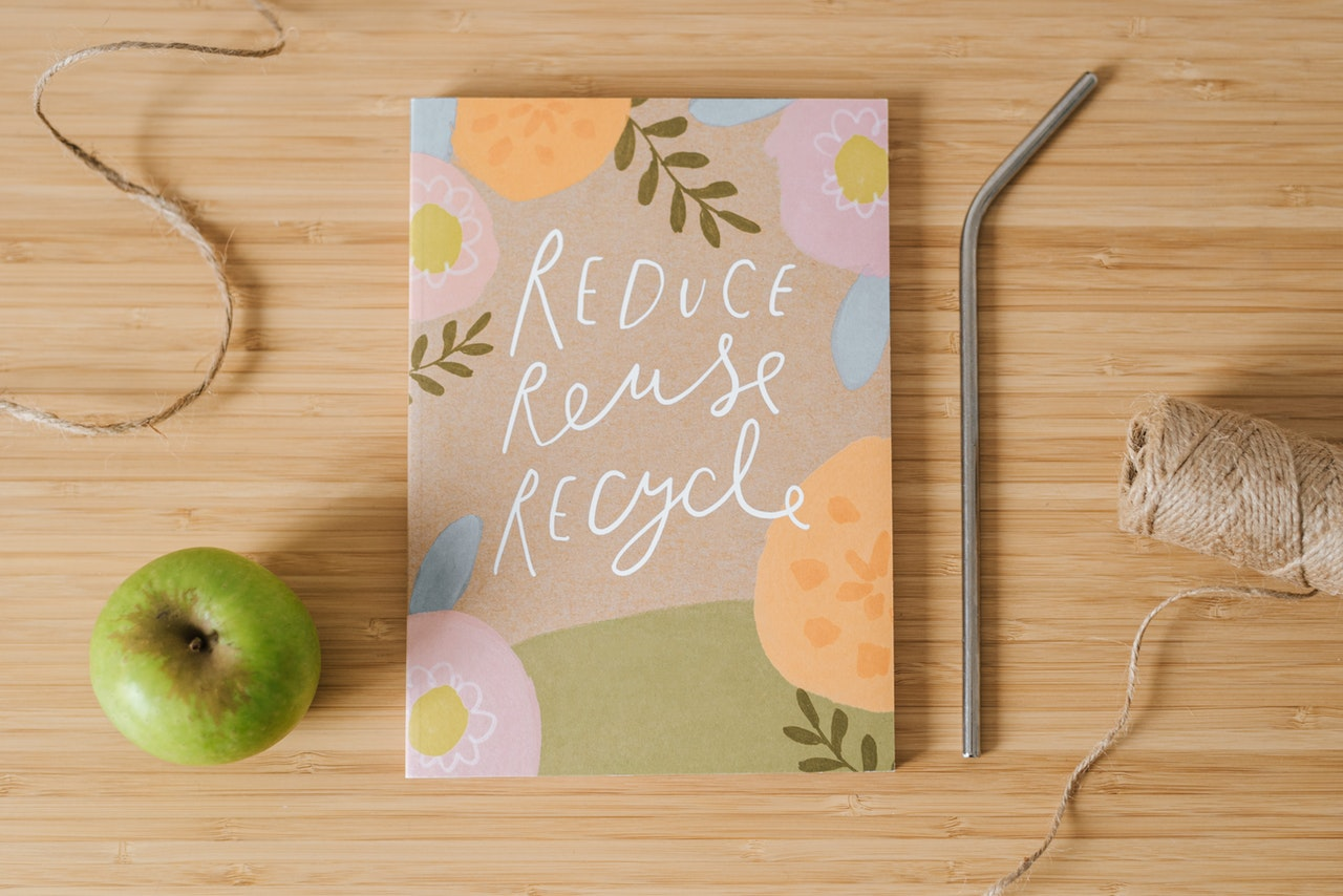 10_A notebook with the words reduce reuse recycle