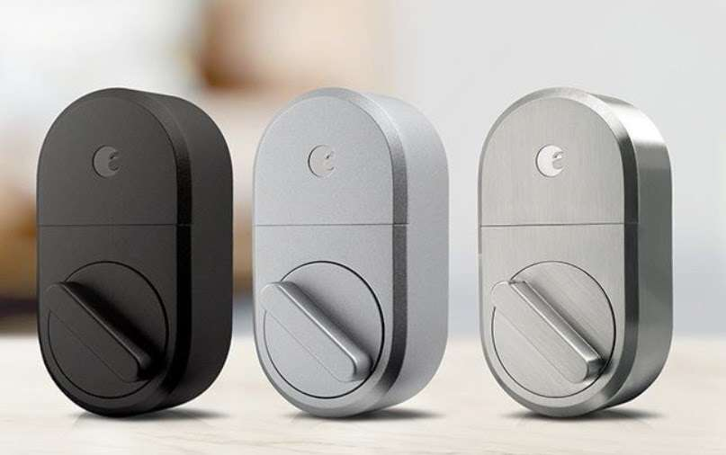 Three August Smart Locks in black, grey and silver finishes