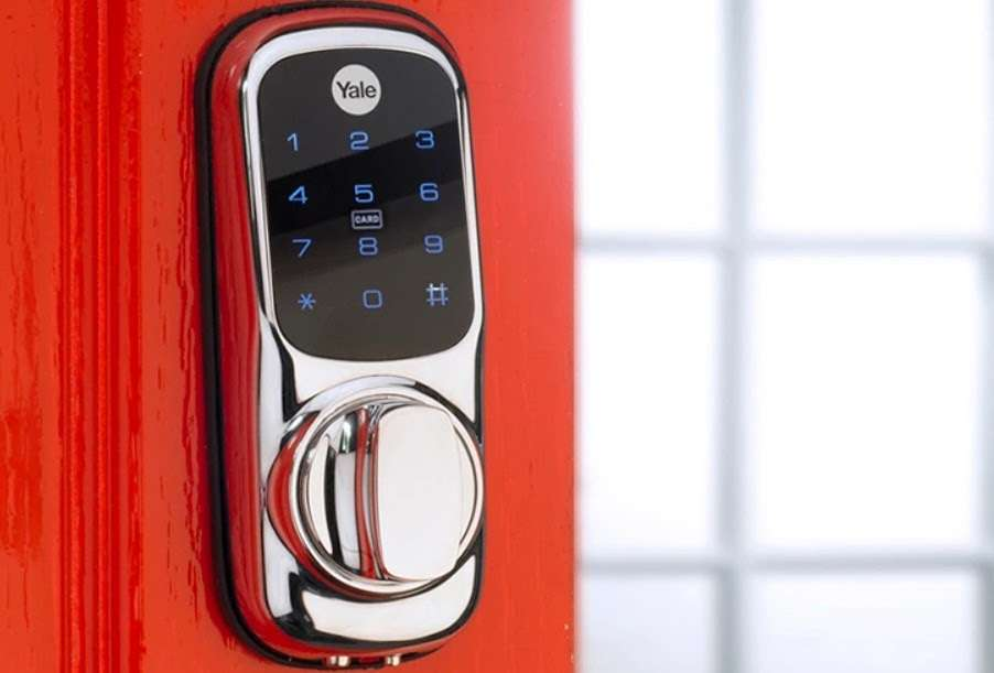 A Yale Keyless Connected lock on a red door