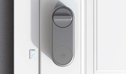 A Yale Linus Smart Door Lock on a white door