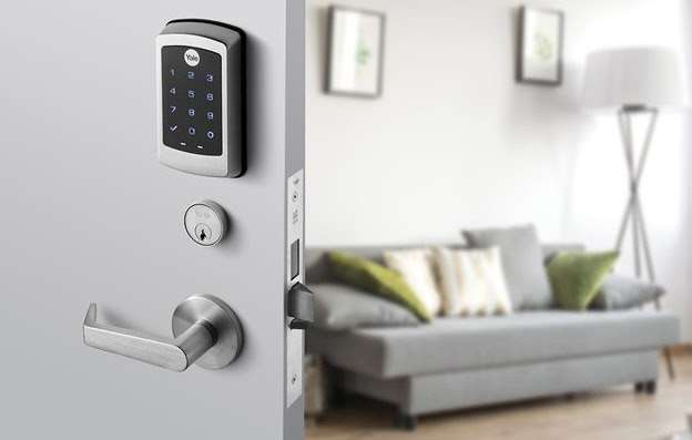 A Yale nexTouch lock opening a door into a living room